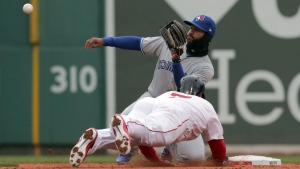 Boston Red Sox's Christian Vazquez is caught trying to steals second base as Toronto Blue Jays shortstop Richard Urena covers during the third inning of the home opener baseball game, Tuesday, April 9, 2019, in Boston. (AP Photo/Charles Krupa)