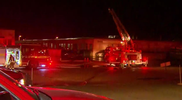 Fire crews are at the scene of multiple explosions at an auto paint shop in Scarborough.