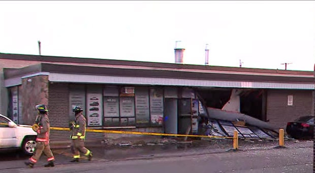 Officials are investigating the cause of multiple explosions at an auto body shop in Scarborough.