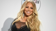 In this Oct. 9, 2018, file photo Mariah Carey poses in the press room at the American Music Awards at the Microsoft Theater in Los Angeles. (Photo by Jordan Strauss/Invision/AP, File)