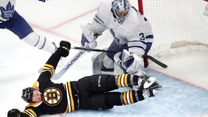 Boston Bruins center Karson Kuhlman slides through the crease after a save on his shot by Toronto Maple Leafs goaltender Frederik Andersen (31) during the third period of Game 1 of an NHL hockey first-round playoff series Thursday, April 11, 2019, in Boston. (AP Photo/Charles Krupa)