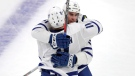 Toronto Maple Leafs center John Tavares, rear, is embraced by left wing Zach Hyman (11) after his empty-net goal against the Boston Bruins during the third period of Game 1 of an NHL hockey first-round playoff series Thursday, April 11, 2019, in Boston. The Leafs won 4-1. (AP Photo/Charles Krupa)