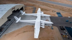 In this May 31, 2017 photo provided by Stratolaunch Systems Corp., the newly built Stratolaunch aircraft is moved out of its hangar for the first time in Mojave, Calif. Prior to his death on Monday, Oct. 15, 2018, Paul Allen invested large sums in technology ventures, research projects and philanthropies, some of them eclectic and highly speculative. Outside of bland assurances from his investment company, no one seems quite sure what happens now. One of Allen's more esoteric ventures is Stratolaunch, which is building an enormous twin-fuselage jet aircraft designed to launch satellites from high altitudes. (Stratolaunch Systems Corp. via AP)