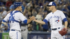 Toronto Blue Jays catcher Luke Maile congratulates pitcher Ken Giles after the Jays defeated the Tampa Bay Rays in American League MLB baseball game action in Toronto Saturday April 13, 2019. THE CANADIAN PRESS/Fred Thornhill