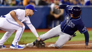 Tampa Bay Rays' Avisail Garcia, right, slides safely into third base after tagging up on a fly ball out as he beats the tag from Toronto Blue Jays third baseman Brandon Drury during eighth inning MLB baseball action in Toronto on Sunday, April 14, 2019. THE CANADIAN PRESS/Frank Gunn