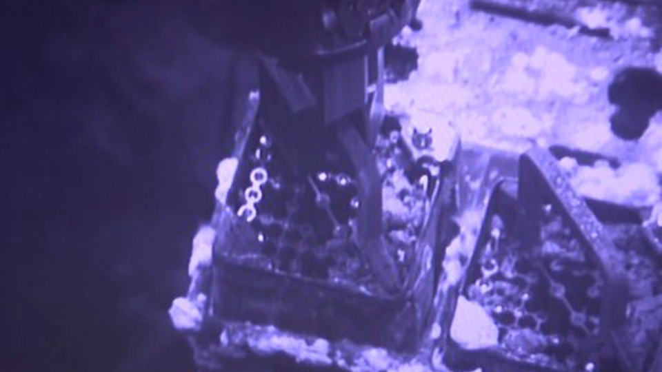 This image released by Tokyo Electric Power Co. (TEPCO) shows an operation to remove fuel from a cooling pool at Unit 3 of the Fukushima nuclear plant in Okuma town, Fukushima prefecture, northeastern Japan, Monday, April 15, 2019. (Tokyo Electric Power Co. via AP)
