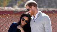 FILE - In this Sunday, Feb. 24, 2019 file photo, Britain's Prince Harry and Meghan, Duchess of Sussex, watch children playing football at a school in the town of Asni, in the Atlas mountains, Morocco. (Facundo Arrizabalaga/Pool via AP, File)