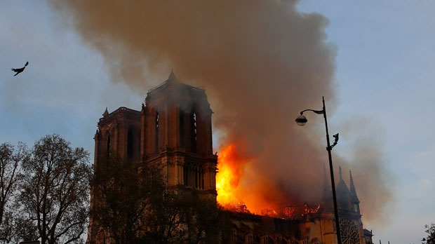 Firefighters scale scaffolding at burning Notre Dame Cathedral to fight the flames