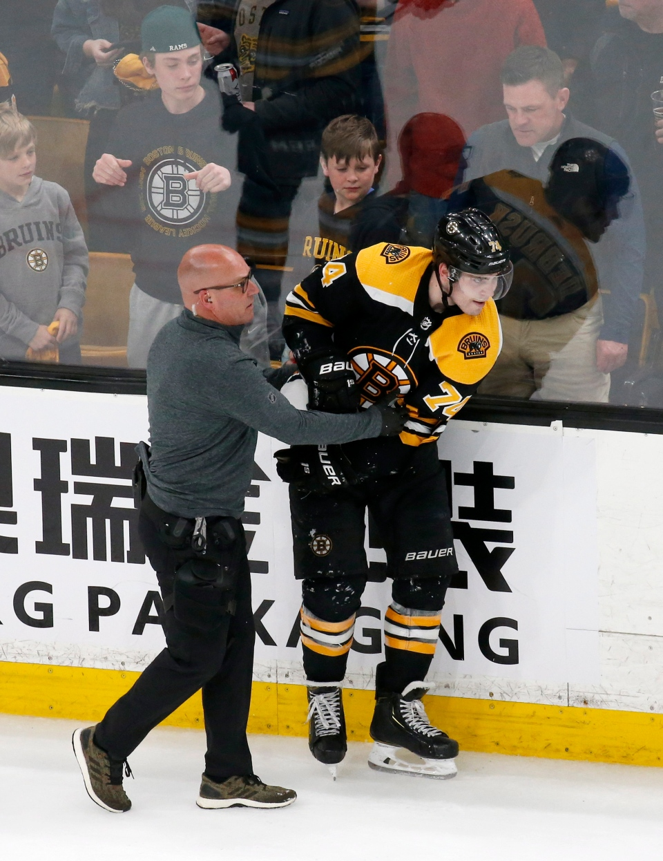 Boston Bruins left wing Jake DeBrusk (74) is helped off the ice by medical personnel after being checked in the head by Toronto Maple Leafs center Nazem Kadri during the third period of Game 2 of an NHL hockey first-round playoff series, Saturday, April 13, 2019, in Boston. (AP Photo/Mary Schwalm)