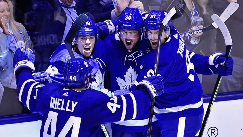 Toronto Maple Leafs centre Auston Matthews (34) celebrates his goal against the Boston Bruins with teammates during second period NHL playoff hockey action in Toronto, on Monday, April 15, 2019. THE CANADIAN PRESS/Frank Gunn
