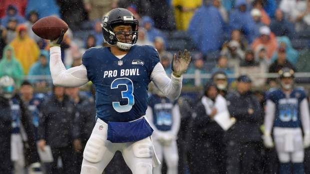8b0e851ca 27, 2019, file photo, NFC quarterback Russell Wilson of the Seattle Seahawks  throws a pass against the AFC during the first half of their NFL Pro Bowl  ...