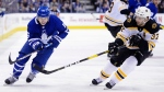 Toronto Maple Leafs right wing Mitchell Marner (16) and Boston Bruins centre Patrice Bergeron (37) battle for the puck during first period NHL playoff hockey action in Toronto, on Monday, April 15, 2019. THE CANADIAN PRESS/Nathan Denette