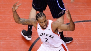 Toronto Raptors forward Kawhi Leonard (2) gestures towards a referee after making a basket during second half NBA playoff basketball action against the Orlando Magic in Toronto, on Tuesday, April 16, 2019. THE CANADIAN PRESS/Nathan Denette