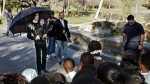 FILE - In this Dec. 17, 2004, file photo, pop star Michael Jackson greets several hundred children who were invited guests at his Neverland Ranch home in Santa Ynez, Calif. (AP Photo/Mark J. Terrill, File)
