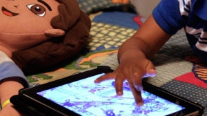 A child plays with an iPad in his bedroom in Metairie, La., on October 21, 2011. A new study links preschoolers who got two hours of screen time or more per day to behavioural problems they experienced at age five. The research looked at more than 2,400 families and compared children who got at least two hours of screentime daily to those who had less than 30 minutes per day. THE CANADIAN PRESS/AP, Gerald Herbert
