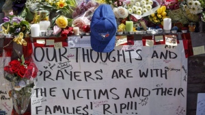 Tributes are seen on a memorial at Yonge St. and Finch Ave. in Toronto on Thursday, April 26, 2018 for the victims of a deadly van attack. Thousands of cards, photos and flowers will be dismantled by city staff at an event in Toronto on Sunday, to be replaced with a permanent memorial for the victims of the deadly van attack.THE CANADIAN PRESS/Cole Burston