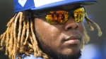 Toronto Blue Jays infielder Vladimir Guerrero Jr. (27) looks on at practice during baseball spring training in Dunedin, Fla., on Monday, February 18, 2019. The Toronto Blue Jays aren't putting a timeline on top prospect Vladimir Guerrero Jr.'s major-league arrival one day after his impressive season debut at triple-A on Thursday night. THE CANADIAN PRESS/Nathan Denette