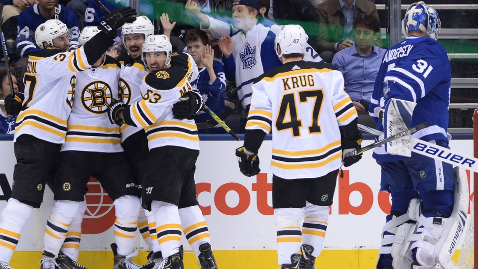 Boston Bruins right wing David Pastrnak, second left, celebrates his goal against Toronto Maple Leafs goaltender Frederik Andersen (31) with teammates during second period NHL playoff hockey action in Toronto on Wednesday, April 17, 2019. THE CANADIAN PRESS/Nathan Denette