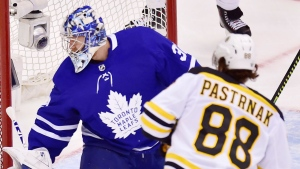 Toronto Maple Leafs goaltender Frederik Andersen (31) looks for the puck as Boston Bruins right wing David Pastrnak (88) scores during second period NHL playoff hockey action in Toronto on Wednesday, April 17, 2019. THE CANADIAN PRESS/Frank Gunn