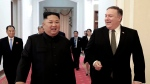 "In this Oct. 7, 2018, file photo provided by the North Korean government, North Korean leader Kim Jong Un, center left, and U.S. Secretary of State Mike Pompeo walk together before their meeting in Pyongyang, North Korea. North Korea said Thursday, April 18, 2019, that it had test-fired a new type of ""tactical guided weapon,"" its first such test in nearly half a year, and demanded that Washington remove Pompeo from nuclear negotiations. Korean language watermark on image as provided by source reads: ""KCNA"" which is the abbreviation for Korean Central News Agency. (Korean Central News Agency/Korea News Service via AP, File)"