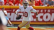 In this Sept. 23, 2018, file photo, San Francisco 49ers quarterback Jimmy Garoppolo runs with the ball during the first half of the team's NFL football game against the Kansas City Chiefs in Kansas City, Mo. Garoppolo has resumed throwing and taking drop backs as he rehabilitates from a major knee injury that derailed his first full season as San Francisco's starting quarterback. The process of coming back is going smoothly and Garoppolo hopes to be able to take part in seven-on-seven drills when the 49ers begin OTAs next month and be fully cleared by the time training camp starts in late July. (AP Photo/Charlie Riedel, File)