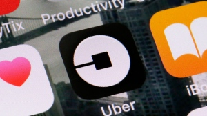 This Tuesday, June 12, 2018, file photo shows the Uber app on a phone in New York. Uber on Thursday, April 18, 2019, said that it is releasing a new feature to help riders ensure they're getting into the right vehicles. The development comes several weeks after a University of South Carolina student was killed after getting into a car she had mistaken for the Uber ride she hailed. (AP Photo/Richard Drew, File)