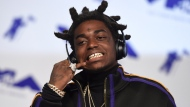 In this Aug. 27, 2017 file photo, Kodak Black arrives at the MTV Video Music Awards at The Forum in Inglewood, Calif. New York state police say rapper Kodak Black was arrested on drug and weapons charges as he tried to cross from Canada into the United States near Niagara Falls. Police say Bill Kapri, whose stage name is Kodak Black, was among three people attempting to enter the United States in a Cadillac Escalade on Wednesday, April 18, 2019.  Black, who was driving, was found with marijuana and officers discovered a Glock 9mm pistol in the vehicle. (Photo by Jordan Strauss/Invision/AP, File)