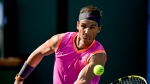 In this March 15, 2019, file photo, Rafael Nadal, of Spain, hits a volley to Karen Khachanov, of Russia, at the BNP Paribas Open tennis tournament in Indian Wells, Calif. (AP Photo/Mark J. Terrill, File)