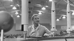 FILE - This May 26, 1961 file photo shows Jerrie Cobb, the nation's first female astronaut candidate, with a display of rockets at a national conference where the leading space experts gathered in Tulsa, Okla. Cobb died in Florida at the age of 88 on March 18, 2019. (AP Photo/William P. Straeter)
