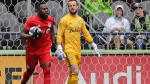 Seattle Sounders goalkeeper Stefan Frei, right, looks on as Toronto FC forward Jozy Altidore, left, carries the ball after Altidore scored his second goal in the MLS soccer match, Saturday, April 13, 2019, in Seattle. The Sounders won 3-2. (AP Photo/Ted S. Warren)
