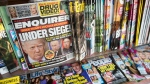 FILE - In this July 12, 2017 file photo, an issue of the National Enquirer featuring President Donald Trump on its cover is displayed on a newsstand in a store in New York. The tabloid's owner, American Media announced Thursday, April 18, 2019, that it is selling the supermarket weekly to James Cohen, the former head of the airport newsstand company Hudson News. (AP Photo/Mary Altaffer, File)