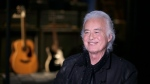 Jimmy Page speaks to a reporter at the Metropolitan Museum of Art in New York, Monday, April 1, 2019. (AP Photo/Seth Wenig)