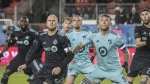 Toronto FC midfielder Michael Bradley (4) and Minnesota United defender Francisco Calvo (5) look for a header front of Minnesota United's net during first half MLS soccer action in Toronto on Friday, April 19, 2019. THE CANADIAN PRESS/Christopher Katsarov