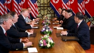 In this Feb. 28, 2019, file photo, U.S. President Donald Trump, third from left, speaks with National Security adviser John Bolton, left, and Secretary of State Mike Pompeo, second from left. during a meeting with North Korean leader Kim Jong Un, second from right, in Hanoi, Vietnam. Kim is cautiously turning up the heat after his unsuccessful summit with Trump in Hanoi two months ago. Though Kim claims he still has a good personal relationship with the U.S. president, he and senior North Korean officials have shown increasing frustration with Trump's top advisers, Pompeo and Bolton. (AP Photo/ Evan Vucci, File)