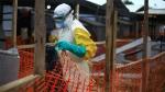 An Ebola health worker is seen at a treatment centre in Beni, Eastern Congo, Tuesday April,16, 2019. (AP Photo/Al-hadji Kudra Maliro)