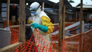 An Ebola health worker is seen at a treatment centre in Beni, Eastern Congo, Tuesday April,16, 2019. (AP Photo/Al-hadji Kudra Maliro)