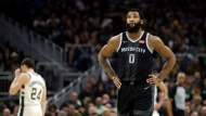 Detroit Pistons' Andre Drummond looks up to the scoreboard during the second half of Game 2 of the team's NBA basketball first-round playoff series against the Milwaukee Bucks on Wednesday, April 17, 2019, in Milwaukee. (AP Photo/Aaron Gash)