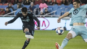 Toronto FC midfielder Alejandro Pozuelo (10) shoots past Minnesota United defender Michael Boxall (15) to score a goal during first half MLS soccer action in Toronto on Friday, April 19, 2019. THE CANADIAN PRESS/Christopher Katsarov