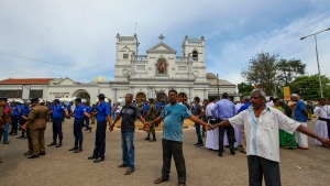 Sri Lankan army soldiers secure the area around St. Anthony's Shrine after a blast in Colombo, Sri Lanka, Sunday, April 21, 2019. More than hundred people were killed and hundreds more hospitalized from injuries in near simultaneous blasts that rocked three churches and three luxury hotels in Sri Lanka on Easter Sunday, a security official told The Associated Press, in the biggest violence in the South Asian country since its civil war ended a decade ago. (AP Photo/ Rohan Karunarathne )