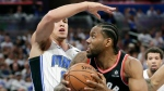 Toronto Raptors' Kawhi Leonard, right, looks looks for a shot as he is defended by Orlando Magic's Aaron Gordon during the first half in Game 3 of a first-round NBA basketball playoff series, Friday, April 19, 2019, in Orlando, Fla. (AP Photo/John Raoux)