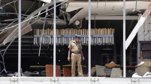 A Sri Lankan Police officer inspects a blast spot at the Shangri-la hotel in Colombo, Sri Lanka, Sunday, April 21, 2019. More than hundred people were killed and hundreds more hospitalized from injuries in near simultaneous blasts that rocked three churches and three luxury hotels in Sri Lanka on Easter Sunday, a security official told The Associated Press, in the biggest violence in the South Asian country since its civil war ended a decade ago.(AP Photo/Eranga Jayawardena)