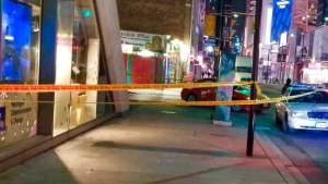 Police tape is shown at the scene of a stabbing investigation near Yonge and Gould streets on Monday morning.