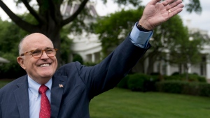 In this Tuesday, May 29, 2018 file photo, Rudy Giuliani, an attorney for President Donald Trump, waves to people during White House Sports and Fitness Day on the South Lawn of the White House, in Washington. Trump's legal team, through an unlikely combination of bluster, legal precedent and a decision to sharply shift tactics, protected their client from a perilous in-person interview and those lawyers took a victory lap this week when a redacted version of special counsel Robert Mueller findings was published, (AP Photo/Andrew Harnik, File)