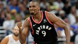 Toronto Raptors' Serge Ibaka reacts after making a basket against the Orlando Magic during the second half in Game 3 of a first-round NBA basketball playoff series, Friday, April 19, 2019, in Orlando, Fla. (AP Photo/John Raoux)