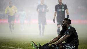 Toronto FC forward Jozy Altidore (17) recovers on the ground after being tackled during second half MLS soccer action against the Minnesota United in Toronto on Friday, April 19, 2019. (THE CANADIAN PRESS/Christopher Katsarov)