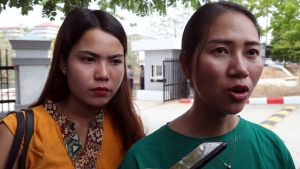 Pan Ei Mon, right, wife of Reuters journalist Wa Lone, talks to journalists as she leaves the Supreme Court along with Chit Su Win, left, wife of Reuters journalist Kyaw Soe Oo, in Naypyitaw, Myanmar, Tuesday, April 23, 2019. (AP Photo/Aung Shine Oo)