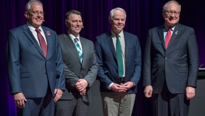 NDP Leader Joe Byrne, , left to right, Progressive Conservative Leader Dennis King, Green Leader Peter Bevan-Baker and Liberal Leader Wade MacLauchlan pose for a photo at the provincial leaders debate at the Harbourfront Theatre in Summerside, P.E.I. on Tuesday, April 16, 2019. Canadians are expected to learn late Tuesday whether the cradle of Confederation is going to give birth to the country's first version of proportional representation. THE CANADIAN PRESS/Andrew Vaughan
