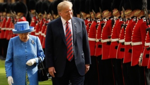 In this July 13, 2018, file photo, President Donald Trump and Britain's Queen Elizabeth II inspect a Guard of Honour, formed of the Coldstream Guards at Windsor Castle in Windsor, England, Friday, July 13, 2018.(AP Photo/Matt Dunham, Pool)