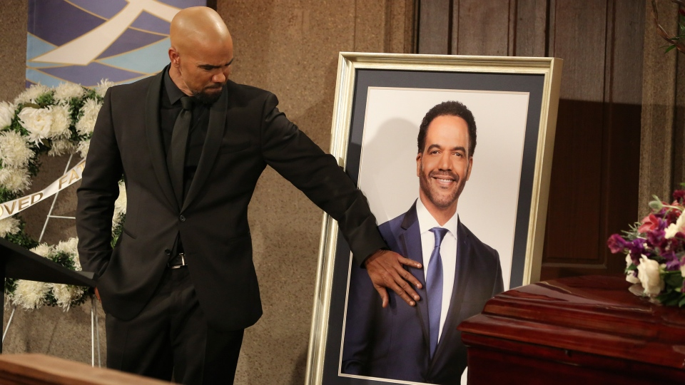 """This image released by CBS shows Shemar Moore portraying Malcolm Winters during a funeral scene for the character Neil Winters, portrayed by the late actor Kristoff St. John, in the daytime series """"The Young and the Restless."""" St. John, who died at age 52 in February of heart disease, helped cement the prominence of major African-American characters in the traditionally white soap opera world. (Michael Yarish/CBS via AP)"""