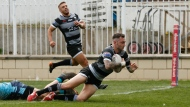 Toronto Wolfpack fullback Gareth O'Brien scores a try as Toronto teammate Matty Russell watches in the Wolfpack's Betfred Championship rugby league match Monday, April 22, 2019 against the Featherstone Rovers. THE CANADIAN PRESS/HO-Toronto Wolfpack-Stephen Gaunt